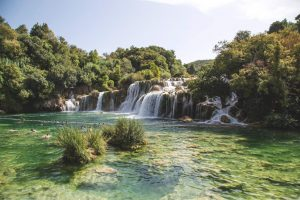 People swimming in Krka river