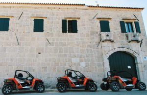 Buggies parked in front of an old building in Zadar