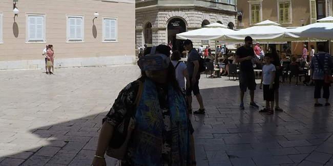 Woman looking through VR glasses in Zadar