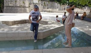 Tourists looking through VR glasses during a Virtual Reality Tour in Zadar at Petar Zoranic Square
