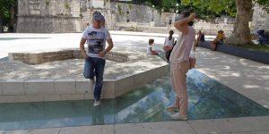 Tourist looking through VR goggles at Petar Zoranić Square in Zadar