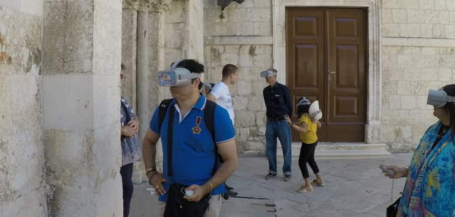 Tourist with VR glasses in front of Church of Chrysogonus in Zadar